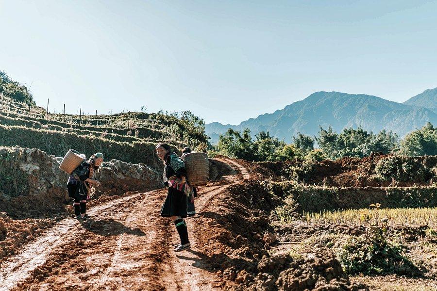 Women carrying back-baskets in Sapa, Vietnam