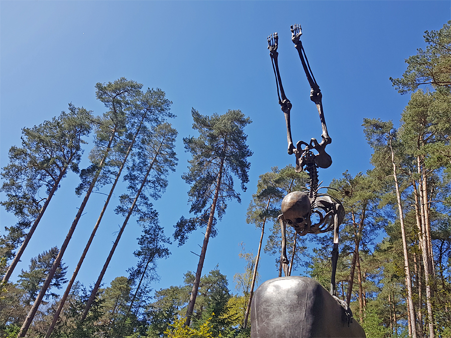 Skelton sculpture 'Backflip' by Wilfred Pritchard at The Sculpture Park in Surrey