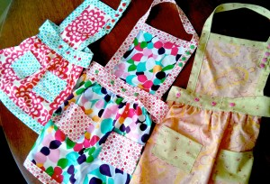 Three aprons for three girls;  I had their moms pick out the fabrics when everyone was over for playgroup one day,
