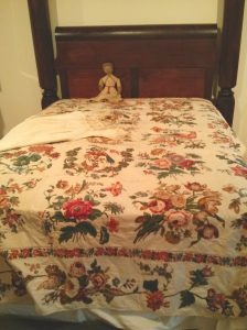 A bed coverlet.  Made with broderie perse, of course.