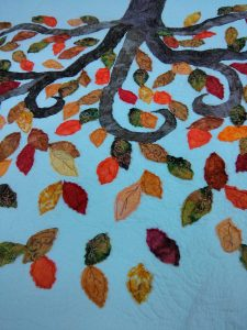 Leaves, all stitched down.  And washed.  Love how this feels, full of movement and texture!  Perfect for a tree of life.