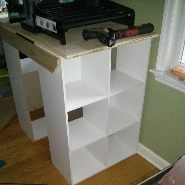 "One cobbled together table from those cube shelves. I had a cutting table we made of the 3x3 cubes a few years ago, , but it was too tall for my 5'4"" to cut comfortably. Made me sad."
