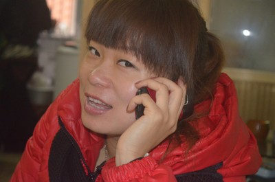 Chinese Woman Talking On Cell Phone