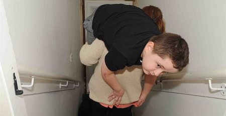 Mother carries son with cerebral palsy up and down the stairs each day - MTG UK