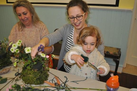 People enjoying flower arranging