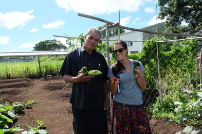 With Losipeli at the research farm with some bitter melon and tomato from the veggie patch