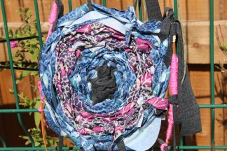Giant woven pansies made from willow and rags. Part of Hate awareness workshops