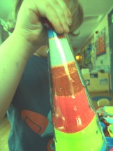 Playing with sand, we made beautiful sand bottles and decorations for a beach themed summer session