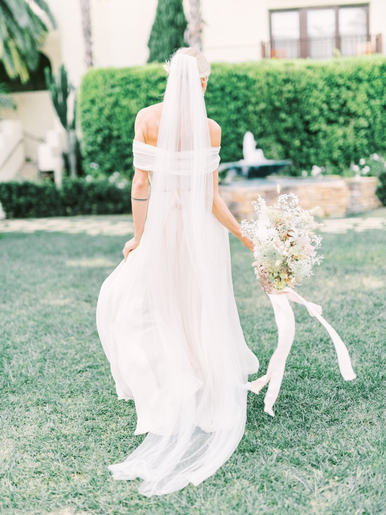 Bride In Garden Courtyard At Estancia La Jolla Wedding Venue In San Diego