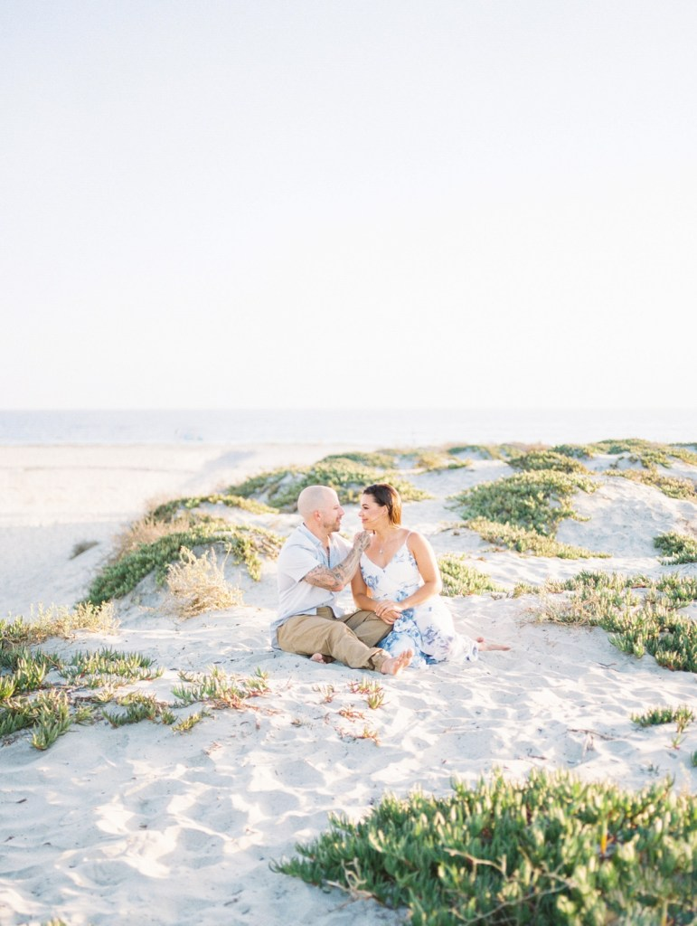 Husband and wife at Hotel Del Coronado family photos | light and airy Coronado family session shot on film by Mandy Ford
