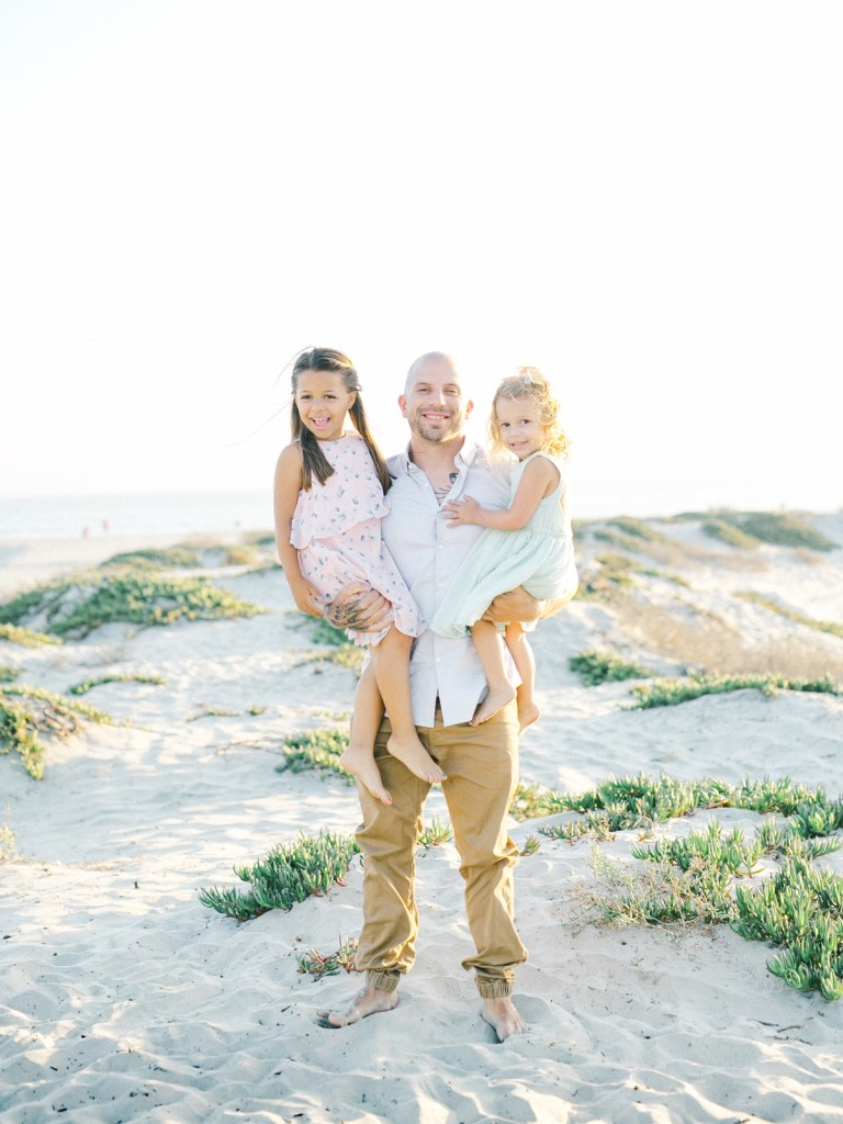 Father and his daughters, pastel family photo wardrobe inspiration | light and airy Coronado family session shot on film by Mandy Ford