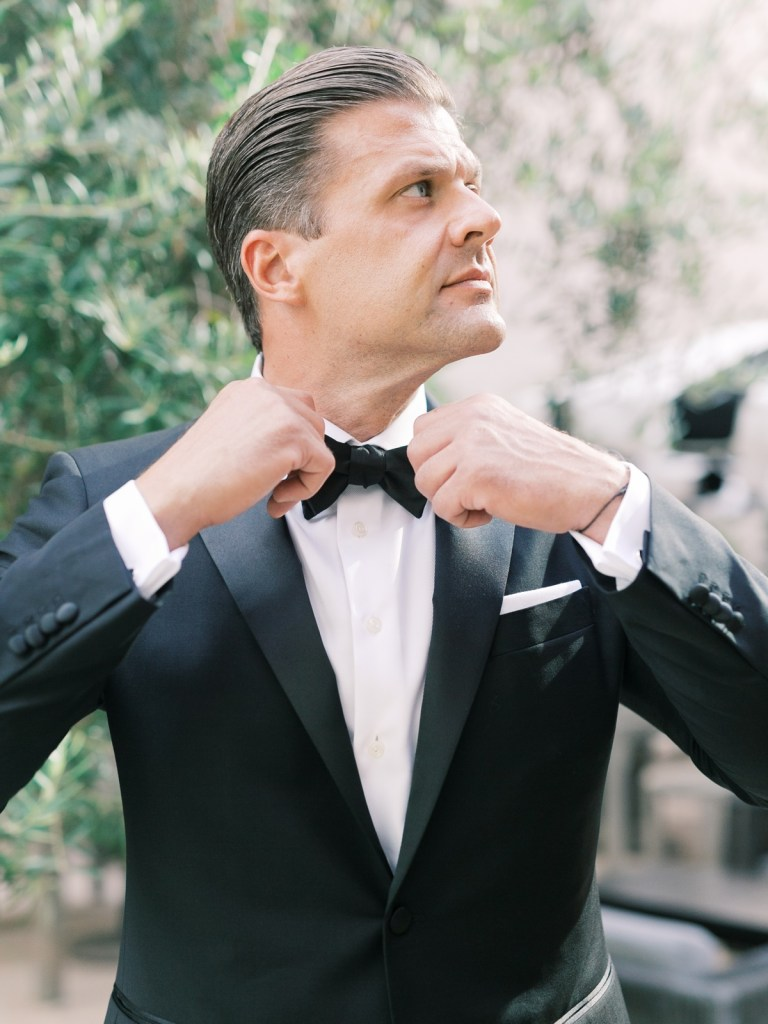 Groom in classic tailored black tux at The Guild Hotel wedding venue in San Diego