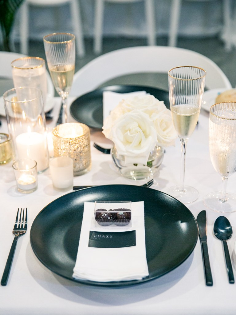 Black and white elegant place settings shot on film in San Diego At The Lane wedding venue