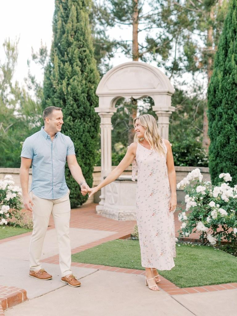 Couple Walking Through Prado Gardens San Diego Wedding Venue At Balboa Park