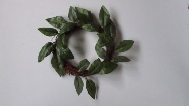Candle ring with green leaves