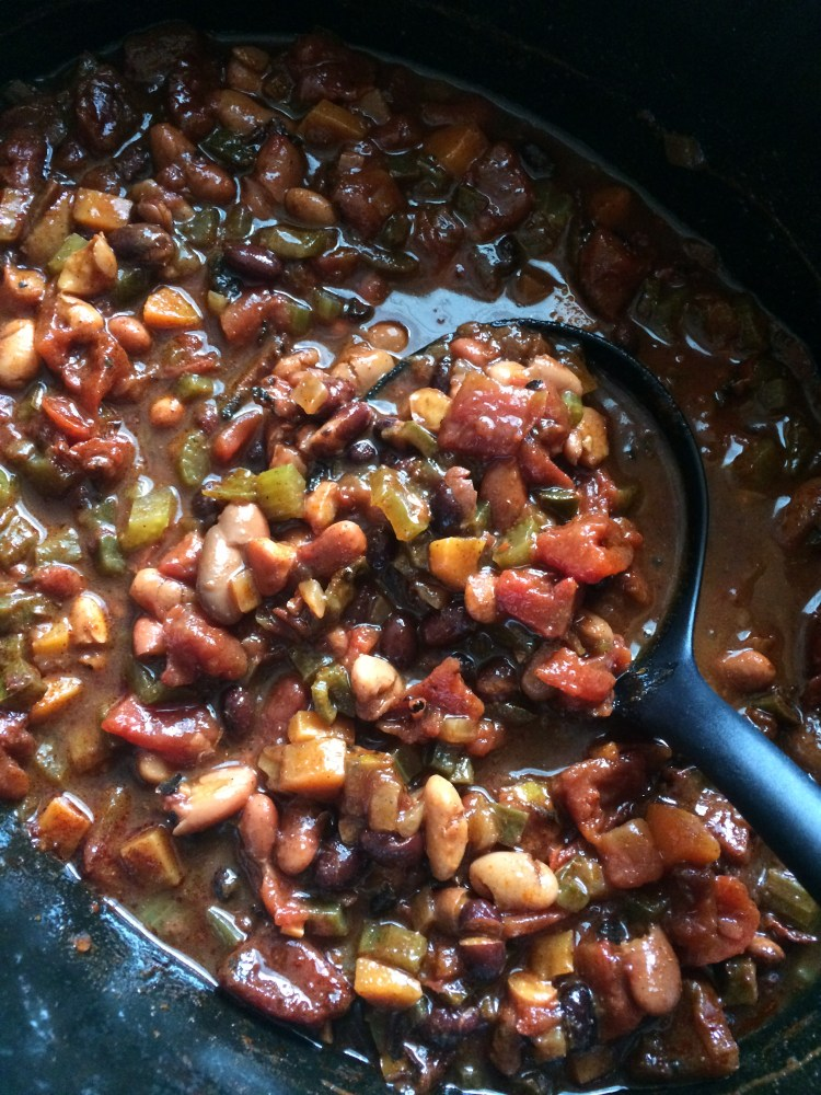 Slow cooker vegetarian chili being ladled out