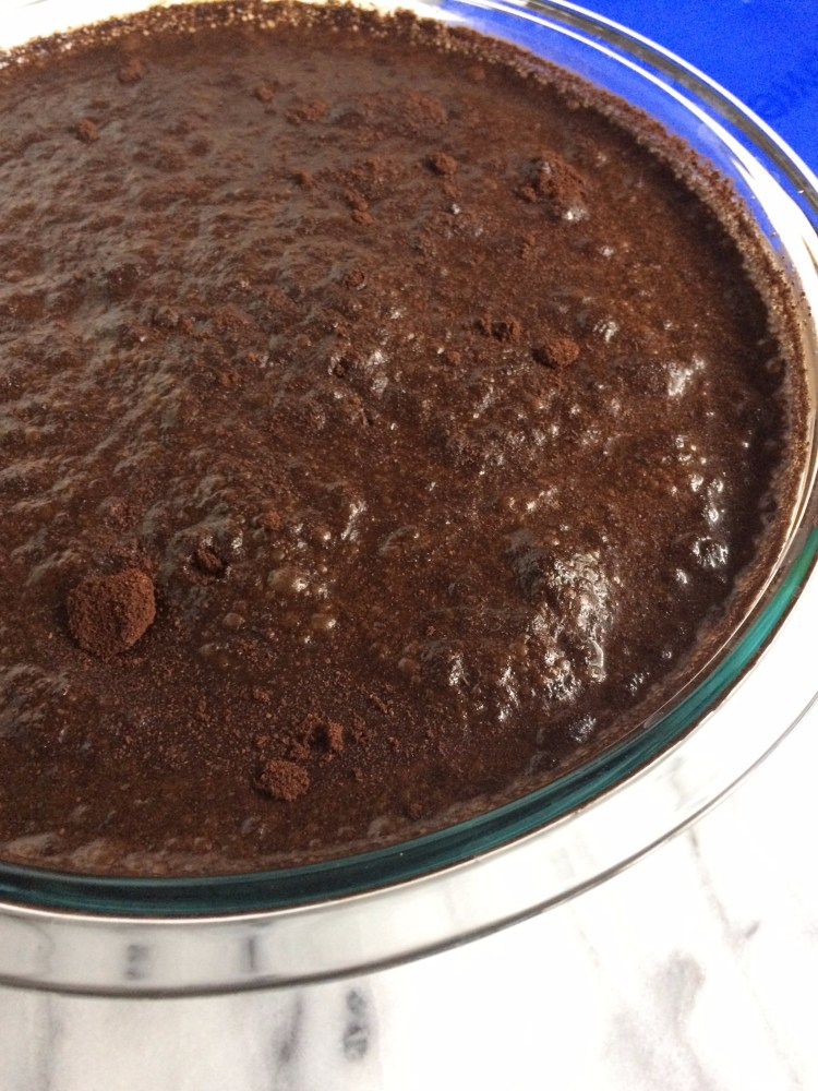 water and coffee grounds stirred up in bowl