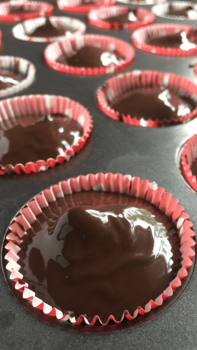 close up of peanut butter cups in muffin tin