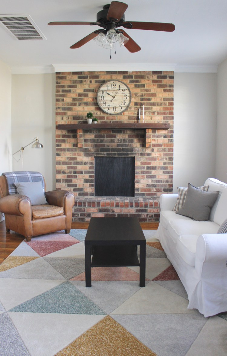 modern living room with brick mantel