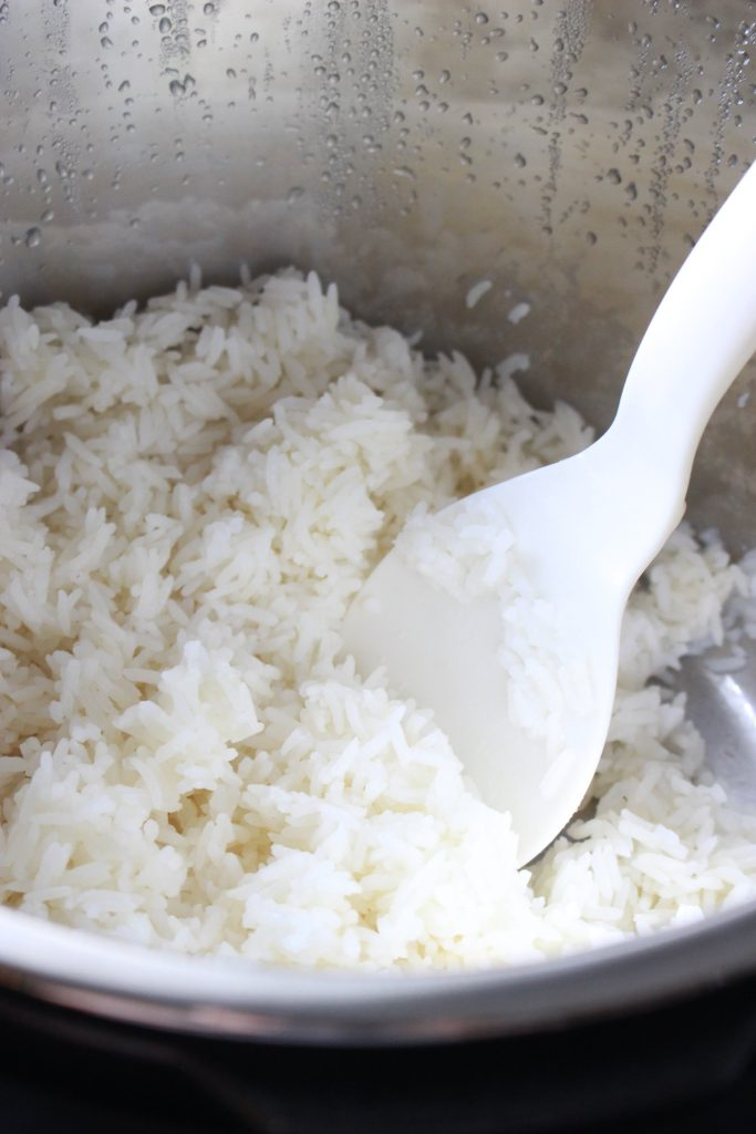 Instant Pot White Rice | Perfectly sticky jasmine rice is so quick and easy in the Instant Pot! A pressure cooker makes restaurant-quality fluffy rice that's so simple, you could make it in your sleep!