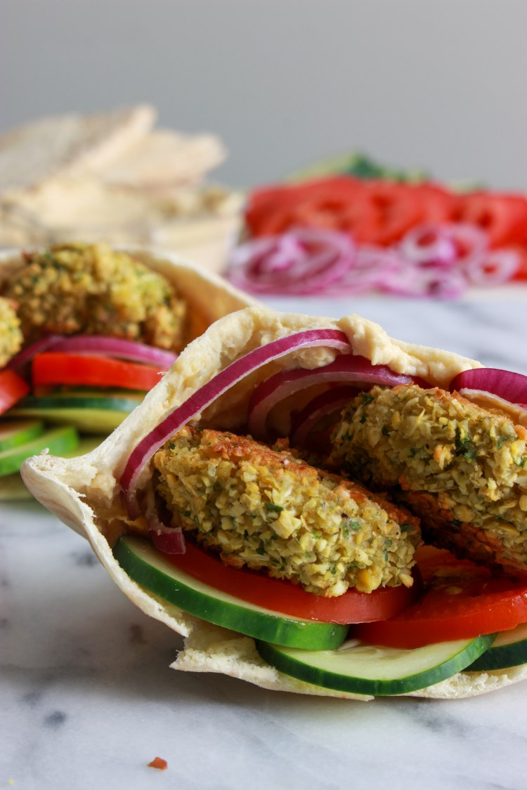 Baked Falafel | An easy recipe for homemade falafel in the oven! Good on salads, sandwiches, rice bowls, and wraps. Unlike fried falafel, baked falafel keeps really well, which makes it perfect for meal prepping.