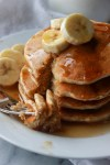 stack of banana pancakes with maple syrup