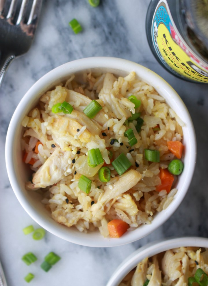 bowl of fried rice with scallions and soy sauce