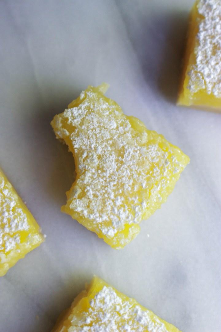 bite out of a homemade lemon bar