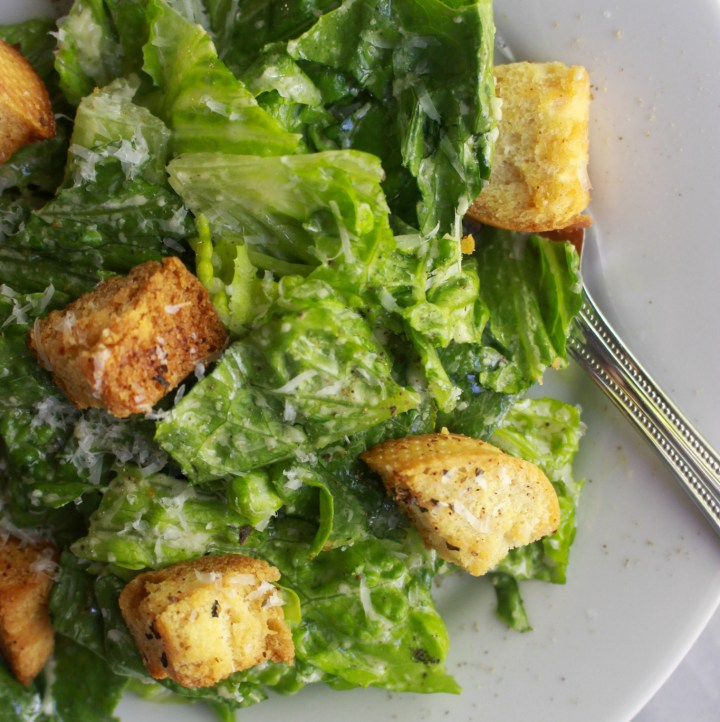 close up of caesar salad with homemade dressing