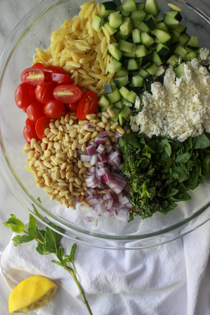 ingredients for orzo pasta salad in a bowl