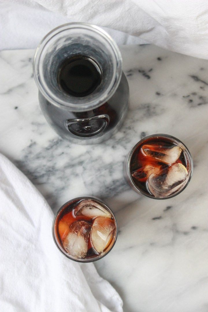 glasses of iced coffee with cold brew in carafe