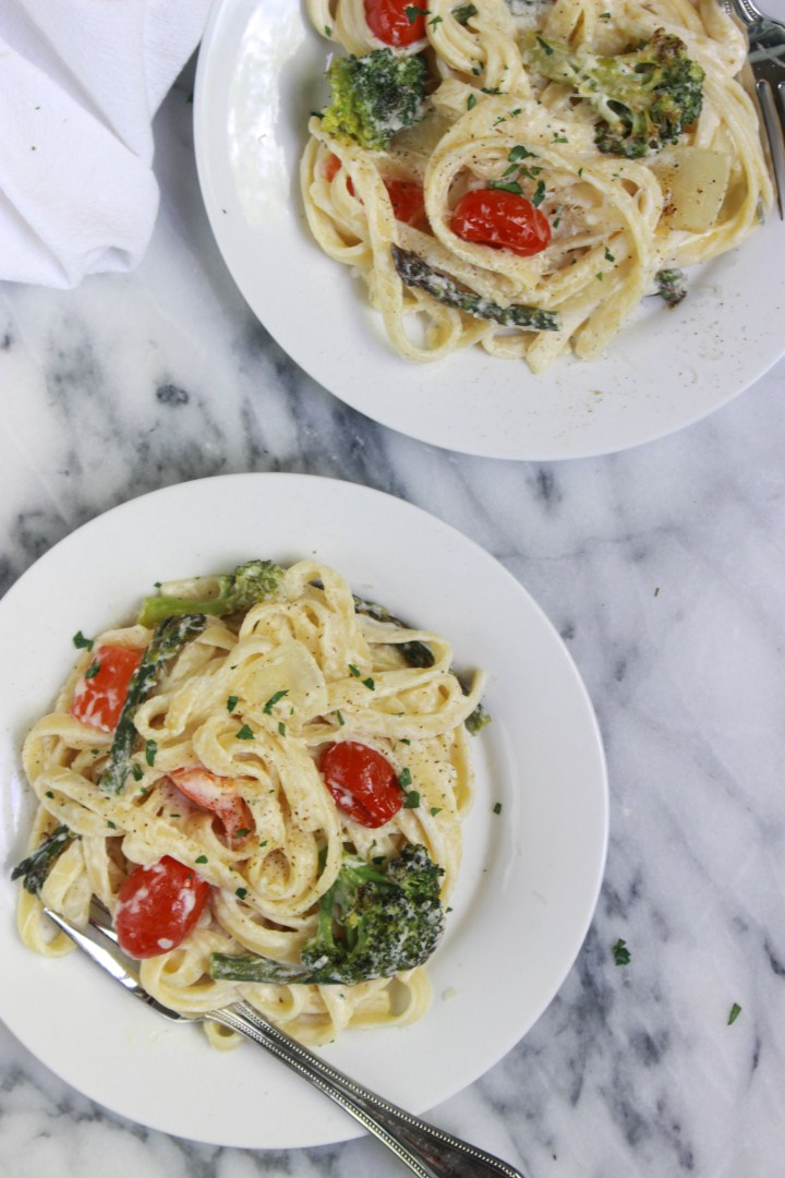 plates of creamy roasted veggie pasta