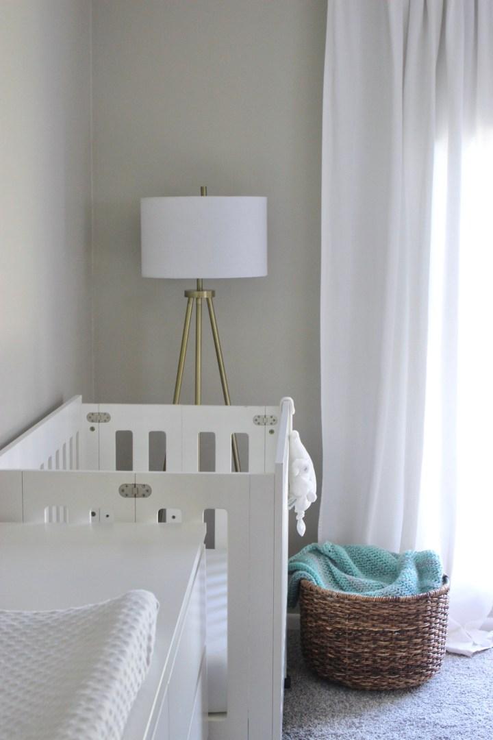 mini crib in master bedroom