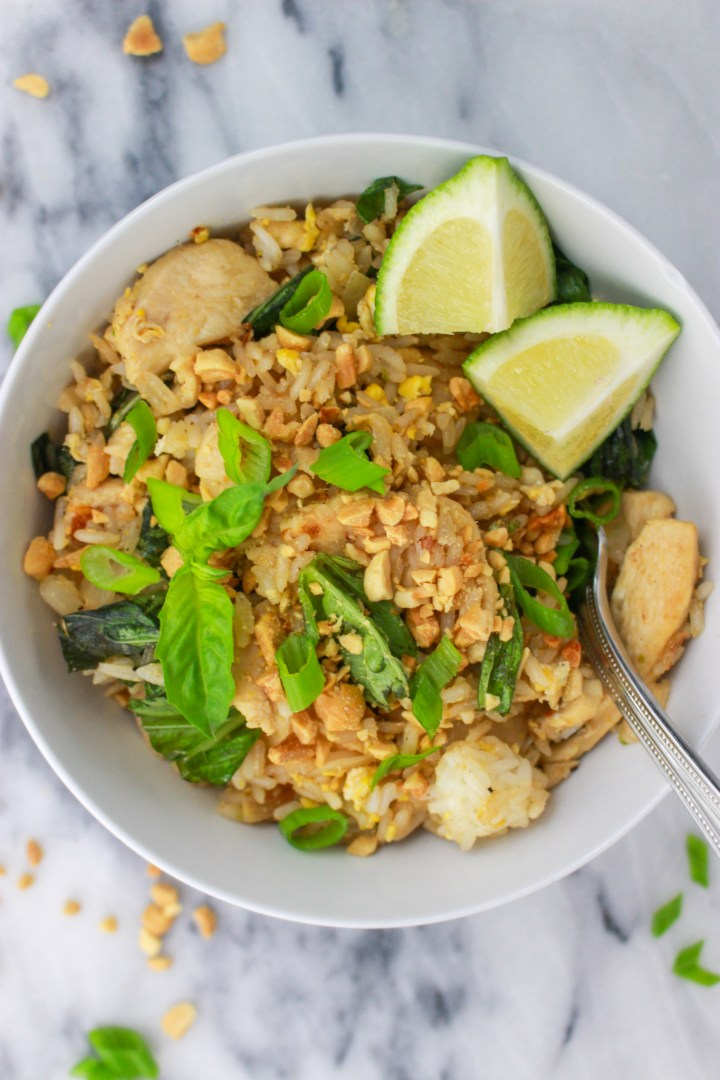 bowl of thai basil fried rice with peanuts and lime