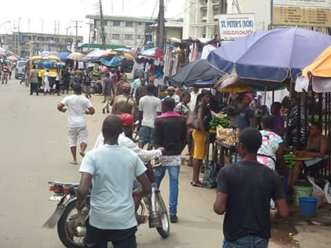 7b752 fb img 1476165731373 701022 - Onitsha Market Jubilates As Security Agents Nab Hoodlums Who Extort Money From Traders (Photos)