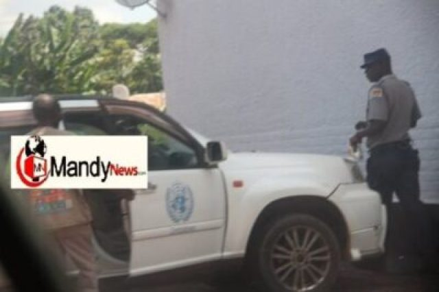 fisher-being-led-to-police-station-2 Zimbabwe United Nations Vice President Arrested Over Sexual Harassment (Photos)