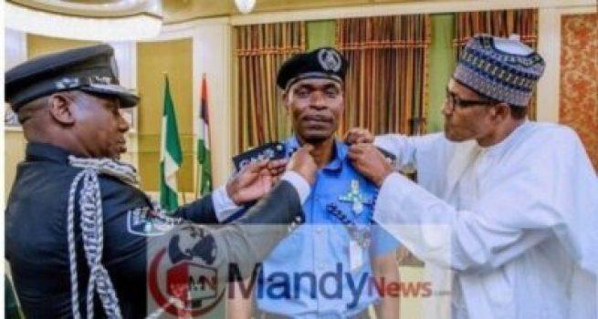 8505226_capture2_jpeg72528766582dfff47d3117d82567eba31174043874 Buhari Decorates New Police IG With New Rank (Photos)