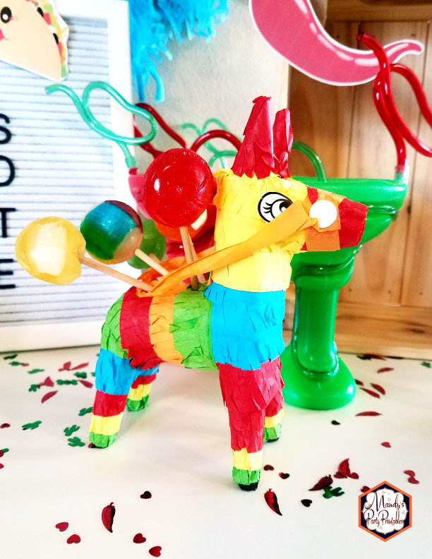 Mini Donkey Pinata holding lollipops from a Taco Bout Love Valentine Taco Party | Mandy's Party Printables #valentineparty #tacoparty #tacoboutlove #ilovetacos #MPP #fiesta