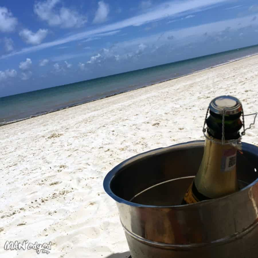A chilled bottle of champagne on the private beaches of Palace Resorts Moon Palace Cancun.