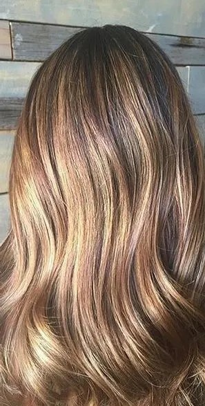 light brunette with warm honey highlights