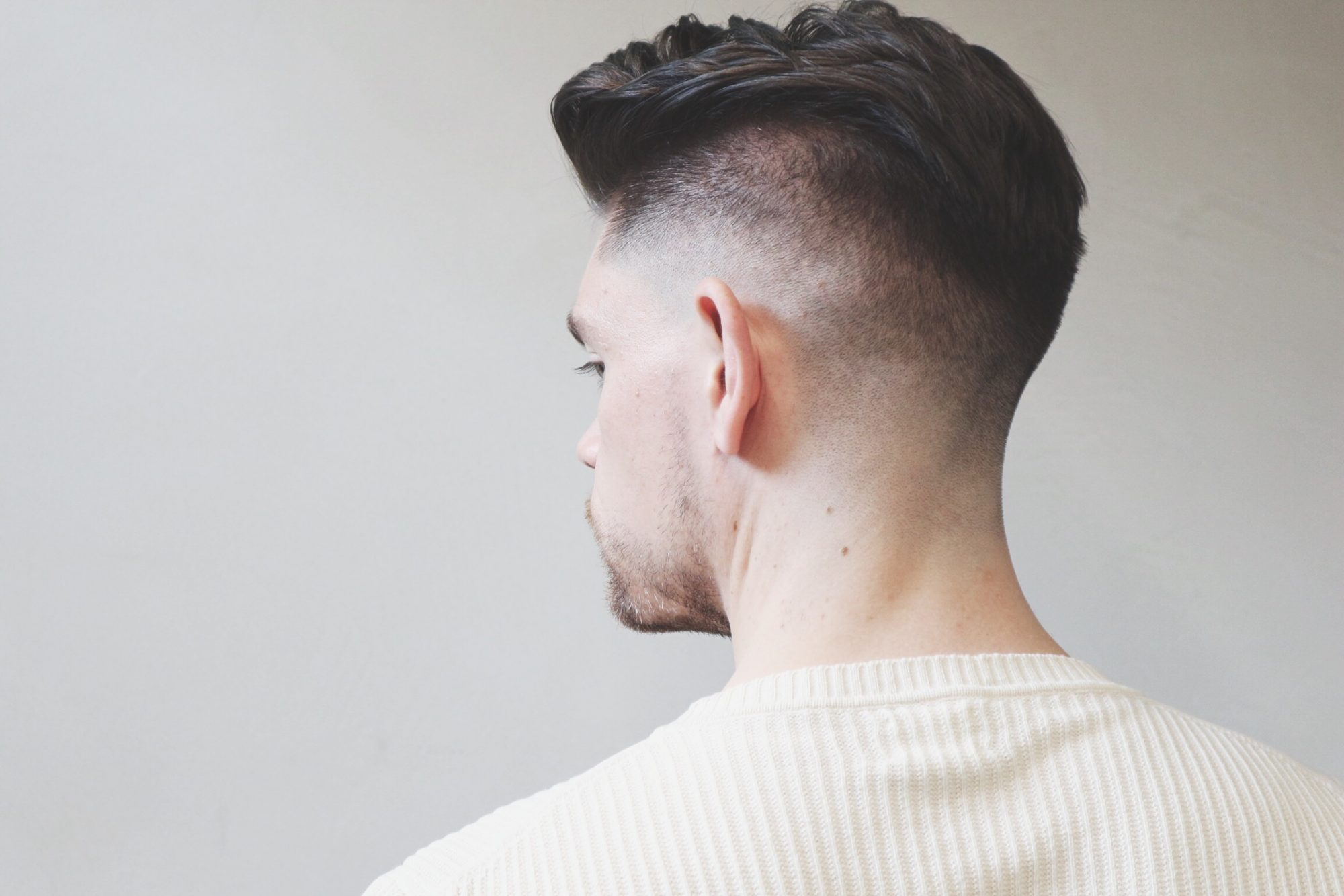 Skin Fade With Side Pomp Summer Haircut And Style Man