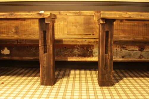 Restaurant bench and tables (rectangular tops), all made from reclaimed woods.