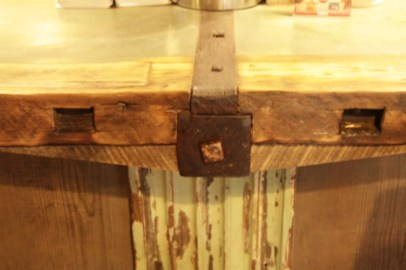 Bar counter with railroad ties and historic moldings.
