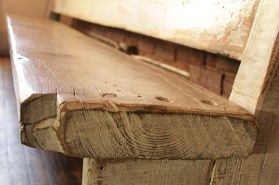 Long sturdy bench with angled back, made from reclaimed woods (detail).