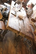 Community table made from reclaimed woods with sewing machine base stands, and Toledo chairs.
