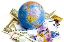bola-dunia-bumi-uang-kertas.jpg