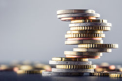 stock-photo-euro-coins-stacked-on-each-other-in-different-positions-382756228.jpg