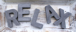 stock-photo-relax-shattered-letters-1144607378.jpg