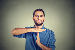 stock-photo-young-man-giving-showing-time-out-hands-gesture-isolated-on-gray-wall-background-327359177.jpg
