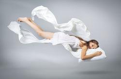 stock-photo-sleeping-girl-flying-in-a-dream-white-linen-flying-through-the-air-light-grey-background-1010662003.jpg